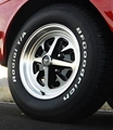14 x 6 Cast Aluminum Magnum 400 Wheel and Tire Package with 205/70 x 14 Tires, Center Caps, HB10A Lug Nuts